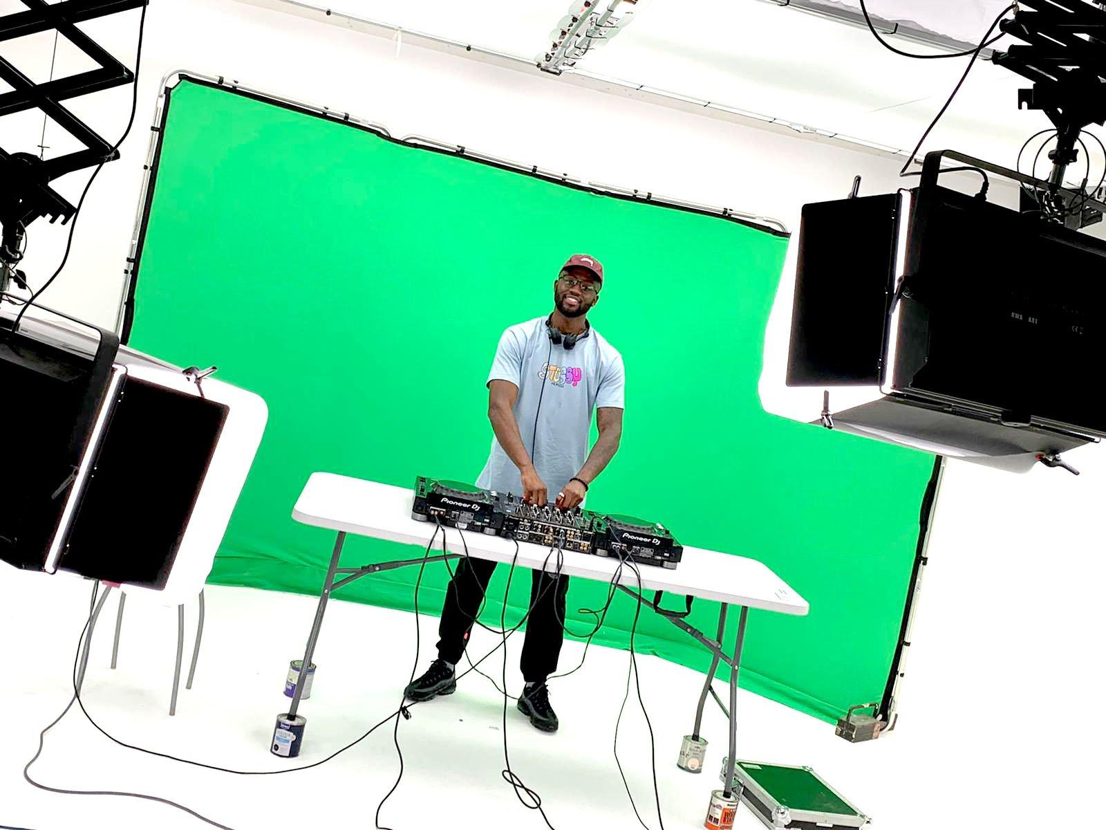 DJ with desks in big brown doors studio